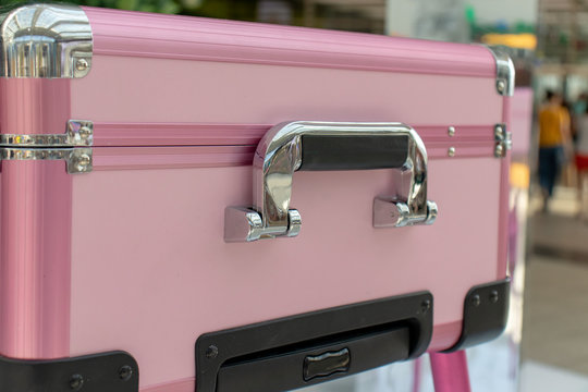 Pink shiny glamour beauty case with chrome handle. Beauty, make-up and fashion concept.
