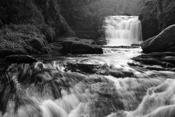 Black and white photo of the waterfall at Watersmeet in Devon