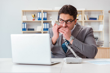 Businessman leaking confidential information over phone