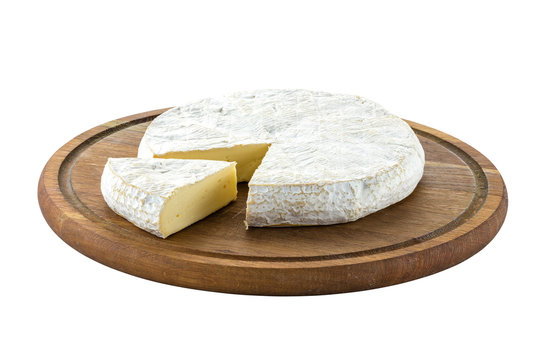 Brie cheese with cut sice on wooden board. With path.