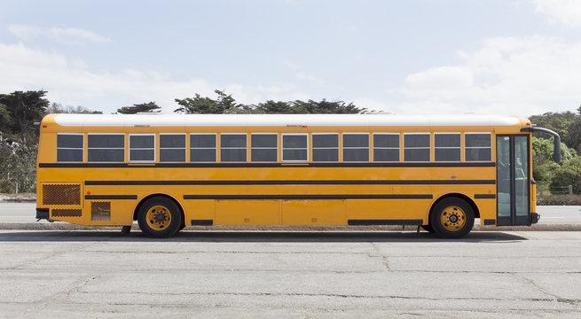 Empty school bus parked in empty lot.
