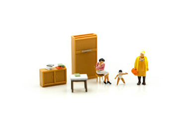 Miniature people : Mother and baby using for concept of Lazy Mom's Day.