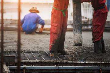 Construction men worker control boom concrete