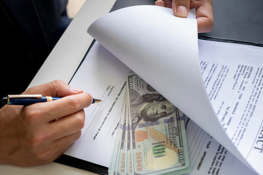 anti bribery and corruption concepts, money offered in file, giving money in file while making deal to agreement