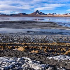 Mountain peaks reflected in the colorful waters of Laguna Colorada, in the Eduardo Avaroa National Reserve, Uyuni, Bolivia