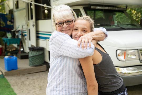Grandma hugging Teenage Granddaughter