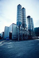 Exterior view of a cement factory. Concrete mixing silo, construction site facilities