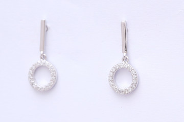 Fashion earring on white background