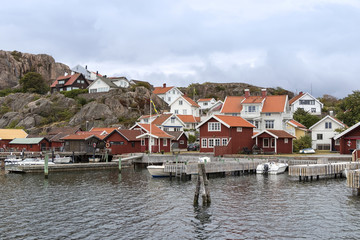 Old buildings and boats at the skerry coast near Bovallastrand (Sweden)