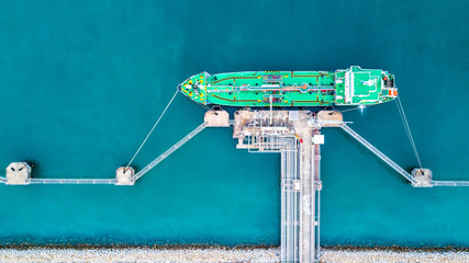 Aerial vie oil cargo tanker ship anchor, Tanker cargo ship boat business operation at oil and gas terminal, View from above.