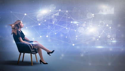 Elegant woman sitting in a sofa with network and connection concept
