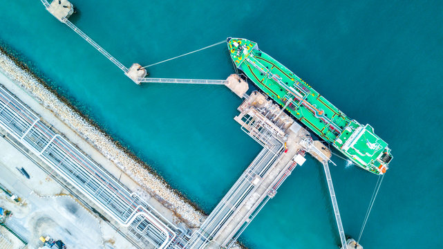 Aerial vie oil tanker ship anchor, Tanker cargo ship boat business operation at oil and gas terminal, View from above.