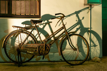 Taichung, Taiwan. 31-May-2018. Old rusted bicycle and its shadow against a wall