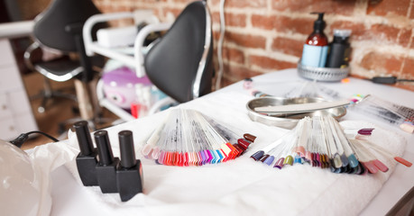 Close-up of workplace with color nail varnishes