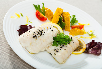 Hake steamed with corn, greens and lemon. Recipe