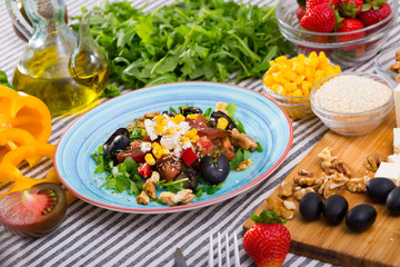 Plate with ready-made salad and its ingredients for recipe