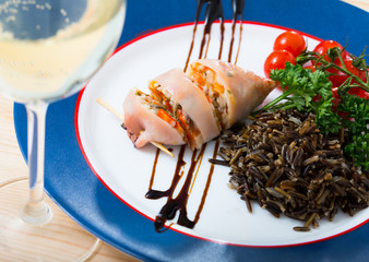 Stuffed squid with peppers, wild rice, eggs and herbs