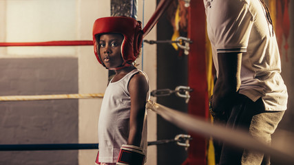 Boxer kid standing in the boxing ring