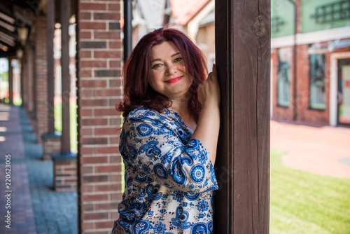 Portrait of attractive plus size mature woman in casual ...