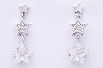 Fashion earring on white background
