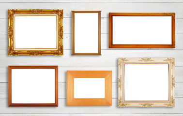 Multiple wood picture frame for interior and architecture decor on white vintage wooden wall background isolated for put photo