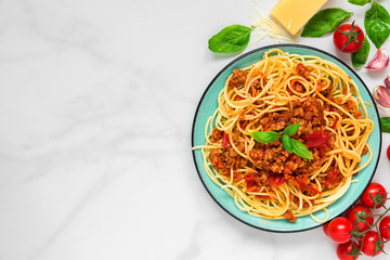 pasta spaghetti bolognese on a blue plate on white marble table. healthy food. view from above Wall mural