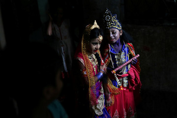 Hindu girls dressed as Radha and Lord Krishna during Janmashtami festival, which marks the birth anniversary of Lord Krishna in Dhaka