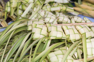 Ketupat, dumpling made of woven palm leaf stuffed with rice