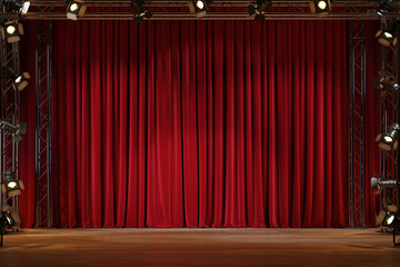 Theater stage with red velvet curtains with spotlights.