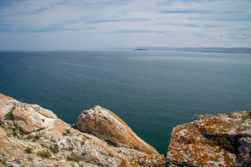 View at Lake Baikal over the rocks covered in lichen.
