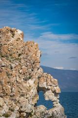 Heart shaped hole in the rock of Kurma's Cape. Lake Baikal, Siberia, Russia.
