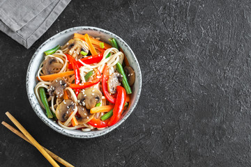 Stir fry with noodles, mushrooms and vegetables