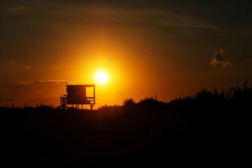 Beautiful sunset over the sandy sea beach