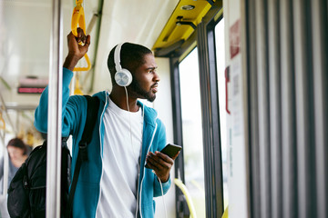 Man Using Phone, Listening Music Traveling In Train