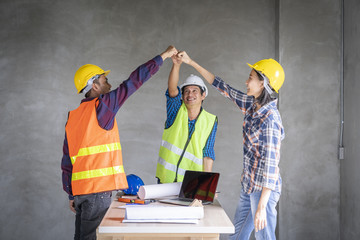 Architect or civil engineer and worker happy when finish project.put up the hand for job success.