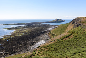 Worms Head, from the Wales Coastal Path. Worms Head is located on the Gower peninsular, South Wales, and can only be reached at low tide