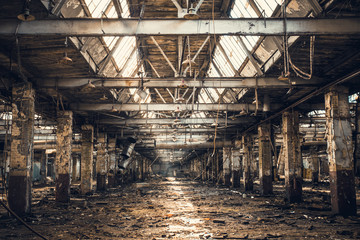 Foto op Aluminium Oude verlaten gebouwen Abandoned ruined industrial warehouse or factory building inside, corridor view with perspective, ruins and demolition concept