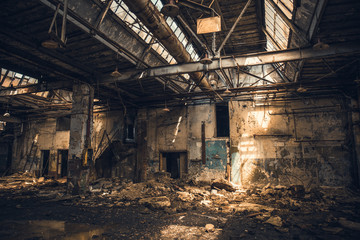 Abandoned ruined industrial warehouse or factory building inside, corridor view with perspective, ruins and demolition concept Fototapete