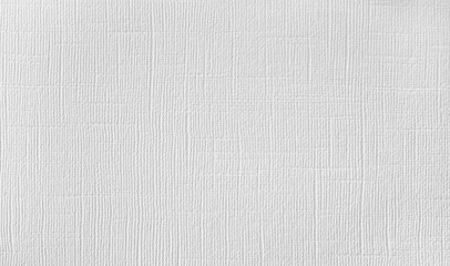 Background of natural material, decorative matting, white wallpaper with linen texture.