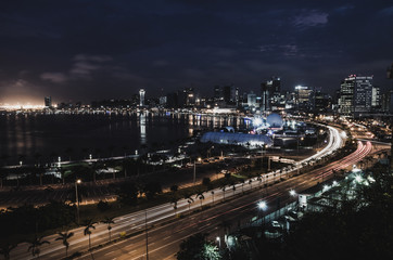 Skyline of capital city Luanda and its seaside during the night, Angola, Africa