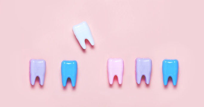 Big teeth on blue and pink background. Minimal concept of teeth health care
