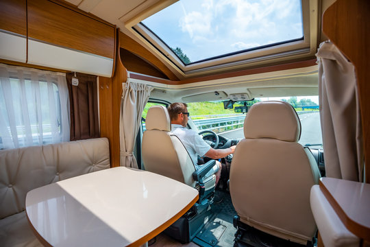 Man driving on a road in the Camper Van RV