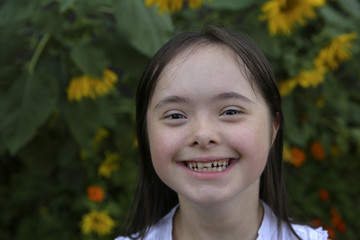 Portrait of little girl smiling in the garden