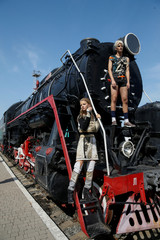 Models pose for a picture after a presentation a creation by Ukrainian designer Jean Gritsfeldt during Ukrainian Fashion Week at the railway station in Kiev