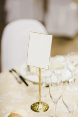Blank poster on a wedding table.