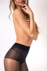 Beautiful young fashion model wearing stockings