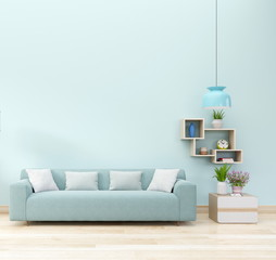 Modern living room interior with sofa and green plants,lamp, cabinet,vase,flower on blue wall background. 3d rendering.