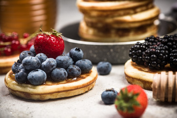 Pancakes with fruits, close up view