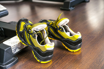Unbranded modern sneaker in the gym. Black-Yellow. Comfortable shoes.