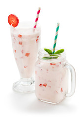Wall Mural - two glasses of milk shake with strawberry isolated on white background